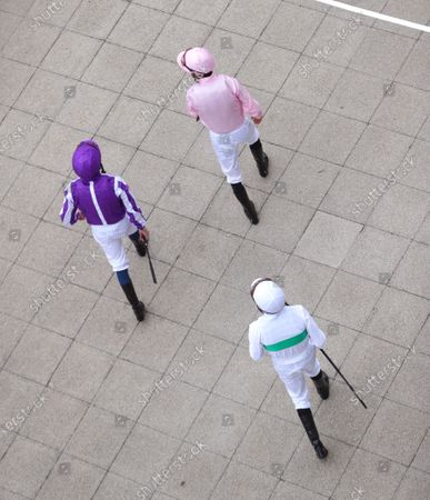 Jockeys walk out ahead of the Investec Derby at Epsom Racecourse. PA Photo. Issue date: Saturday July 4, 2020. See PA story RACING Epsom. Photo credit should read: David Davies/PA Wire