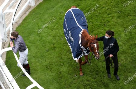 Serpentine and Emmet McNamara in the winners enclosure after victory in the Investec Derby at Epsom Racecourse. PA Photo. Issue date: Saturday July 4, 2020. See PA story RACING Epsom. Photo credit should read: David Davies/PA Wire