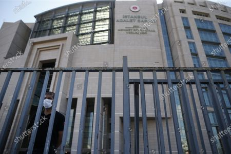 Turkish police officer guards one of the entrances to a court in Istanbul, where the trial in absentia of two former aides of Saudi Crown Prince Mohammed bin Salman and 18 other Saudi nationals over the 2018 killing of Washington Post columnist Jamal Khashoggi, is scheduled to begin. Turkish prosecutors earlier this year indicted the 20 Saudi nationals over Khashoggi's grisly killing at the Saudi Consulate in Istanbul that cast a cloud of suspicion over Prince Mohammed