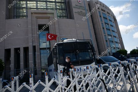 Turkish police officer guards one of the entrances to a court in Istanbul, where the trial in absentia of two former aides of Saudi Crown Prince Mohammed bin Salman and 18 other Saudi nationals over the 2018 killing of Washington Post columnist Jamal Khashoggi, was scheduled to begin. Turkish prosecutors have indicted the 20 Saudi nationals over Khashoggi's grisly killing at the Saudi Consulate in Istanbul that cast a cloud of suspicion over Prince Mohammed and are seeking life prison terms for defendants who have all left Turkey.Saudi Arabia rejected Turkish demands for the suspects' extradition and put them on trial in Riyadh