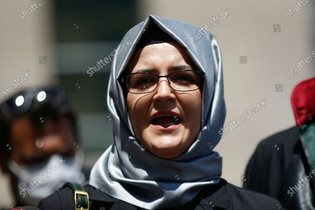 Hatice Cengiz, the fiancee of slain Saudi journalist Jamal Kashoggi, talks to members of the media outside a court in Istanbul, where the trial in absentia of two former aides of Saudi Crown Prince Mohammed bin Salman and 18 other Saudi nationals over the 2018 killing of the Washington Post columnist had began. Turkish prosecutors have indicted the 20 Saudi nationals over Khashoggi's grisly killing at the Saudi Consulate in Istanbul that cast a cloud of suspicion over Prince Mohammed and are seeking life prison terms for defendants who have all left Turkey. Saudi Arabia rejected Turkish demands for the suspects' extradition and put them on trial in Riyadh