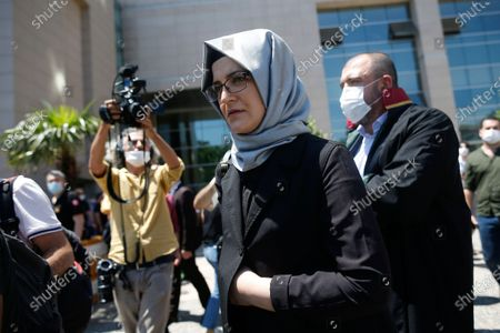 Hatice Cengiz, the fiancee of slain Saudi journalist Jamal Kashoggi, leaves a court in Istanbul, where the trial in absentia of two former aides of Saudi Crown Prince Mohammed bin Salman and 18 other Saudi nationals over the 2018 killing of the Washington Post columnist had began. Turkish prosecutors have indicted the 20 Saudi nationals over Khashoggi's grisly killing at the Saudi Consulate in Istanbul that cast a cloud of suspicion over Prince Mohammed and are seeking life prison terms for defendants who have all left Turkey. Saudi Arabia rejected Turkish demands for the suspects' extradition and put them on trial in Riyadh