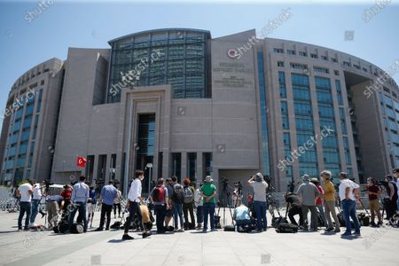Members of the media, work outside a court in Istanbul, where the trial in absentia of two former aides of Saudi Crown Prince Mohammed bin Salman and 18 other Saudi nationals over the 2018 killing of Saudi journalist Jamal Kashoggi had began. Turkish prosecutors have indicted the 20 Saudi nationals over Khashoggi's grisly killing at the Saudi Consulate in Istanbul that cast a cloud of suspicion over Prince Mohammed and are seeking life prison terms for defendants who have all left Turkey. Saudi Arabia rejected Turkish demands for the suspects' extradition and put them on trial in Riyadh
