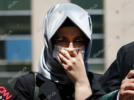 Hatice Cengiz, the fiancee of slain Saudi journalist Jamal Kashoggi, reacts as she talks to members of the media outside a court in Istanbul, where the trial in absentia of two former aides of Saudi Crown Prince Mohammed bin Salman and 18 other Saudi nationals over the 2018 killing of the Washington Post columnist had began. Turkish prosecutors have indicted the 20 Saudi nationals over Khashoggi's grisly killing at the Saudi Consulate in Istanbul that cast a cloud of suspicion over Prince Mohammed and are seeking life prison terms for defendants who have all left Turkey. Saudi Arabia rejected Turkish demands for the suspects' extradition and put them on trial in Riyadh
