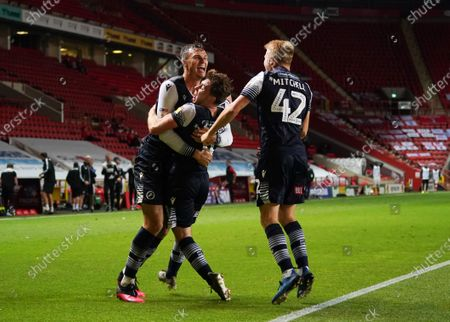 Jake Cooper of Millwall celebrates scoring the opening goal with Ben Thompson and Billy Mitchell