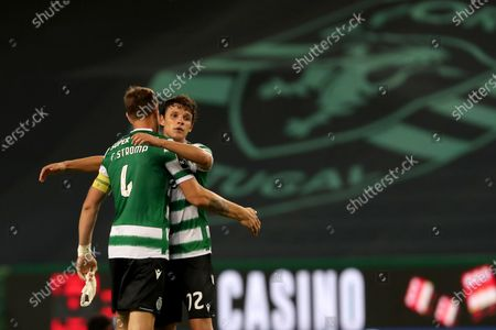 Sebastian Coates (L) of Sporting celebrates with teammate Eduardo Quaresma after a Portuguese League football match between Sporting CP and Gil Vicente in Lisbon, Portugal, Wednesday, July 1, 2020.