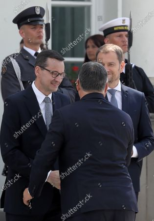(L-R) Polish Prime Minister Mateusz Morawiecki, Hungarian PM Victor Orban and Slovak PM Igor Matovic during official welcome ceremony at the Belvedere Palace before the Visegrad Group prime ministers meeting in Warsaw, Poland, 03 July 2020. Poland's presidency of the Visegrad Group will be inaugurated by V4 country prime ministers at their summit meeting in Warsaw on 03 July.