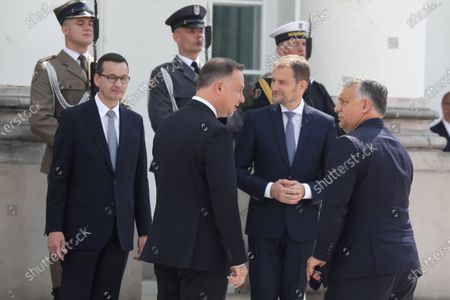 (L-R) Polish Prime Minister Mateusz Morawiecki, Polish President Andrzej Duda, Slovak PM Igor Matovic and Hungarian PM Victor Orban during official welcome ceremony at the Belvedere Palace before the Visegrad Group prime ministers meeting in Warsaw, Poland, 03 July 2020. Poland's presidency of the Visegrad Group will be inaugurated by V4 country prime ministers at their summit meeting in Warsaw on 03 July.