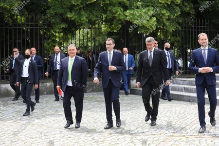 (L-R) Hungarian Prime Minister Victor Orban, Polish PM Mateusz Morawiecki, Czech PM Andrej Babis and Slovak PM Igor Matovic walk at the Lazienki Park (Royal Baths Park) during the Visegrad Group prime ministers meeting in Warsaw, Poland, 03 July 2020. Poland's presidency of the Visegrad Group will be inaugurated by V4 country prime ministers at their summit meeting in Warsaw on 03 July.