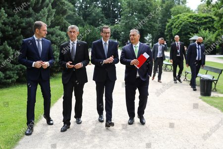 (R-L) Hungarian Prime Minister Victor Orban, Polish PM Mateusz Morawiecki, Czech PM Andrej Babis and Slovak PM Igor Matovic walk at the Lazienki Park (Royal Baths Park) during the Visegrad Group prime ministers meeting in Warsaw, Poland, 03 July 2020. Poland's presidency of the Visegrad Group will be inaugurated by V4 country prime ministers at their summit meeting in Warsaw on 03 July.