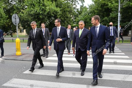 (R-L) Slovak Prime Minister Igor Matovic, Hungarian PM Victor Orban, Polish PM Mateusz Morawiecki and Czech PM Andrej Babis after a walk at the Lazienki Park (Royal Baths Park) during the Visegrad Group prime ministers meeting in Warsaw, Poland, 03 July 2020. Poland's presidency of the Visegrad Group will be inaugurated by V4 country prime ministers at their summit meeting in Warsaw on 03 July.