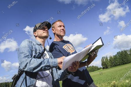Finnish film maker Renny Harlin (R) discusses details with cinematographer Matti Eerikainen (L) as he directs a new movie titled 'Luokkakokous 3' (lit. Class Reunion 3) near Helsinki, Finland, 03 July 2020. Harlin, who lives and works nowadays mainly in China, is known for directing blockbuster movies such as 'Die Hard 2' and 'A Nightmare on Elm Street 4'. The movie is believed to be an action comedy that is planned to be release in 2021.