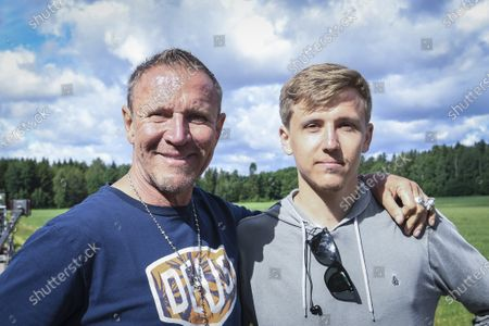 Finnish film maker Renny Harlin (L) poses for photographs with his son Lucas Harlin (R) as he directs a new movie titled 'Luokkakokous 3' (lit. Class Reunion 3) near Helsinki, Finland, 03 July 2020. Harlin, who lives and works nowadays mainly in China, is known for directing blockbuster movies such as 'Die Hard 2' and 'A Nightmare on Elm Street 4'. The movie is believed to be an action comedy that is planned to be release in 2021.