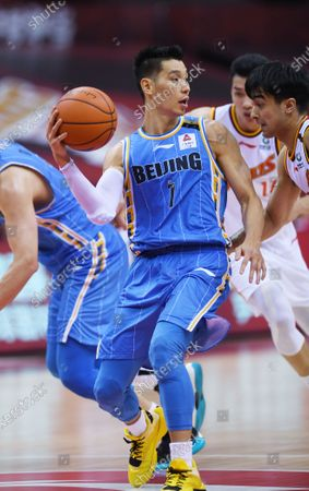 Jeremy Lin (2nd L) of Beijing Ducks passes the ball during a match between Beijing Ducks and Bayi Rockets at the 2019-2020 Chinese Basketball Association (CBA) league in Qingdao, east China's Shandong Province, July 3, 2020.