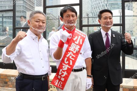 A candidate Taisuke Ono (C) smiles with Japan Restoration Party Secretary General Nobuyuki Baba (L) and former Democratic Party leader Seiji Maehara (R) as they deliver campaign speeches for the Tokyo gubernatorial election in Tokyo on Friday, July 3, 2020. Tokyo gubernatorial election will be held on July 5.
