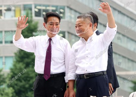 Japan Restoration Party Secretary General Nobuyuki Baba (R) and former Democratic Party leader Seiji Maehara (L) react to audience after they delivered campaign speeches for a candidate Taisuke Ono for the Tokyo gubernatorial election in Tokyo on Friday, July 3, 2020. Tokyo gubernatorial election will be held on July 5.
