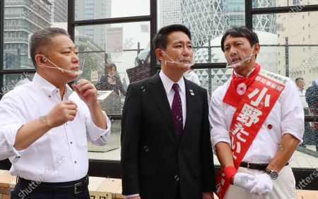 A candidate Taisuke Ono (R) smiles with Japan Restoration Party Secretary General Nobuyuki Baba (L) and former Democratic Party leader Seiji Maehara (C) as they deliver campaign speeches for the Tokyo gubernatorial election in Tokyo on Friday, July 3, 2020. Tokyo gubernatorial election will be held on July 5.