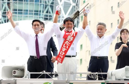 A candidate Taisuke Ono (C) smiles with Japan Restoration Party Secretary General Nobuyuki Baba (R) and former Democratic Party leader Seiji Maehara (L) after they delivered campaign speeches for the Tokyo gubernatorial election in Tokyo on Friday, July 3, 2020. Tokyo gubernatorial election will be held on July 5.