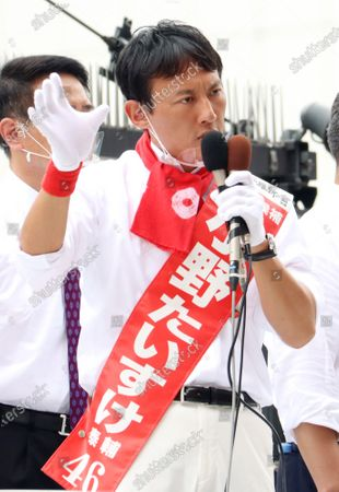 A candidate Taisuke Ono, former Kumamoto prefecture vice Governor delivers a campaign speech for the Tokyo gubernatorial election in Tokyo on Friday, July 3, 2020. Tokyo gubernatorial election will be held on July 5.