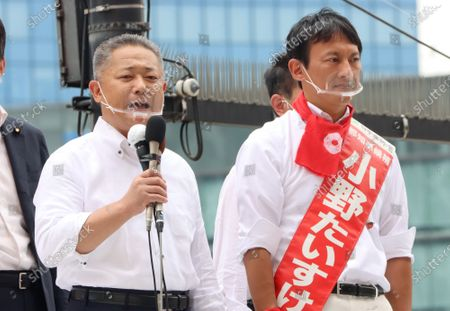 Stock Image of Japan Restoration Party Secretary General Nobuyuki Baba (L) delivers a campaign speech for a candidate Taisuke Ono (R), former Kumamoto prefecture vice Governor for the Tokyo gubernatorial election in Tokyo on Friday, July 3, 2020. Tokyo gubernatorial election will be held on July 5.