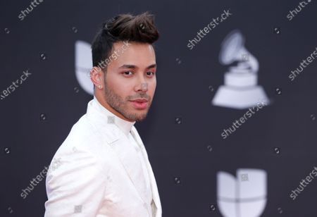 Prince Royce at the 20th Latin Grammy Awards in Las Vegas. Royce says he got a wake-up call with a COVID-19 diagnosis and now wants to try and wake others too. The Latin star told The Associated Press on Thursday that he is recovering from the virus. He says he decided to speak up out of a growing frustration with seeing people going out and gathering without protection