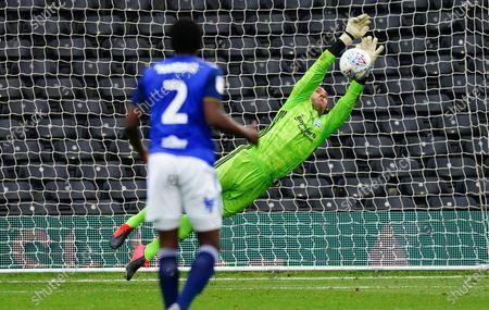 Goalkeeper Lee Camp of Birmingham City denies Joe Bryan of Fulham