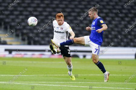Harrison Reed of Fulham battles with Dan Crowley of Birmingham City