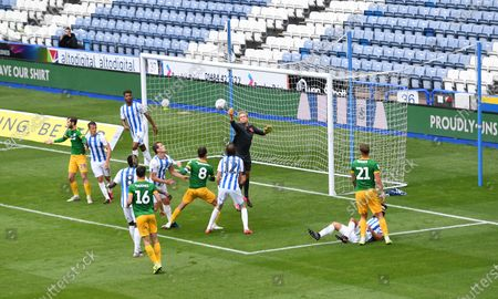 Jonas Lossl goalkeeper of Huddersfield Town punches the ball clear
