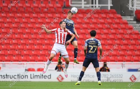 Stock Image of Barnsley's Mads Anderson wins a header from Stoke's Sam  Vokes.