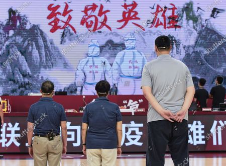 Chinese Basketball Association (CBA) president Yao Ming (R), Chinese renowned respiratory specialist Zhong Nanshan (L) and his wife Li Shaofen, a former Chinese National Women's Basketball team player, pay their tribute to the professionals who fight against the COVID-19 before a match between Jiangsu Dragons and Guangdong Southern Tigers at the 2019-2020 Chinese Basketball Association (CBA) league in Dongguan, south China's Guangdong Province, July 3, 2020.