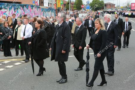 Stock Image of Sinn Fein's (Left to right) President Mary Lou McDonald, former leader Gerry Adams and Michelle O'Neill follow  Irish Republican mourners for the funeral of Bobby Storey in Andersonstown, west Belfast for the funeral of veteran republican Bobby Storey who died last week in England.