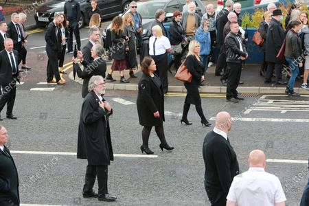 Sinn Fein's (left to right) Gerry Adams, Mary Lou McDonaldf and Michelle O'Neill follow the funeral of veteran republican Bobby Storey in Andersonstown, west Belfast for the funeral who died last week in England.