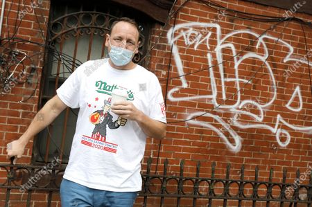 Competitive eating champion Joey Chestnut poses for photographs before the weigh-in for the Nathan's Famous July Fourth hot dog eating contest in Brooklyn, New York, USA, 03 July 2020. The weigh-in was held in a private, socially-distanced ceremony in a Brooklyn neighborhood due to coronavirus pandemic.