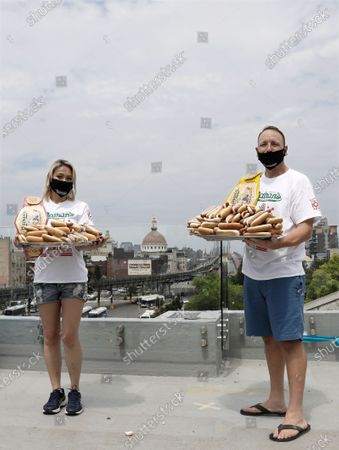 Competitive eating champions Miki Sudo (L) and Joey Chestnut pose with plates of hot dogs at the weigh-in for the Nathan's Famous July Fourth hot dog eating contest in Brooklyn, New York, USA, 03 July 2020. The weigh-in was held in a private, socially-distanced ceremony in a Brooklyn neighborhood due to coronavirus pandemic.