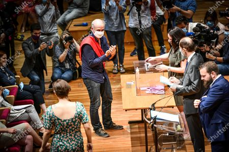 Bordeaux en lutte elected member Philippe Poutou votes during a session of Bordeaux city council in Bordeaux on July 3, 2020 before Hurmic's official election as new mayor of Bordeaux, five days after the second round of the mayoral elections in France.