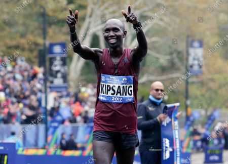 Dated, Wilson Kipsang of Kenya reacts after crossing the finish line second in the men's division of the New York City Marathon in New York, USA. Former marathon world record holder Wilson Kipsang was banned for four-years after a series of missed doping tests, according to a ruling published Friday July 3, 2020, by the Athletics Integrity Unit