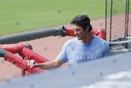 Atlanta Braves pitcher Cole Hamels walks into the dugout during team practice at Truist Park, in Atlanta