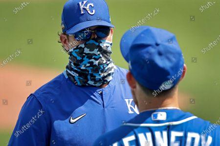 Kansas City Royals manager Mike Matheny talks to pitcher Ian Kennedy during baseball practice at Kauffman Stadium, in Kansas City, Mo