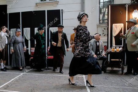 Romanian Jewish actress Maia Morgenstern, right, performs outdoors as spectators and artists use designated spaces in order to observe social distancing rules in Bucharest, Romania, . Artists of the Jewish State Theatre staged an outdoor performance, based on the works of Yiddish author Sholem Aleichem's and Romanian playwright Ion Luca Caragiale's works, with a limited number of spectators due to the COVID-19 pandemic imposed restrictions