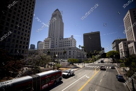 Stock Photo of Five planes fly over and skytype artist Yosimar Reyes' words 'Chinga Tu Migra' and artist Patrisse Cullors 'Care not Cages' over City Hall and landmarks in downtown Los Angeles, California, USA, 03 July 2020. In Plain Sight is a coalition of 80 artists united to create an artwork dedicated to the abolition of immigrant detention.