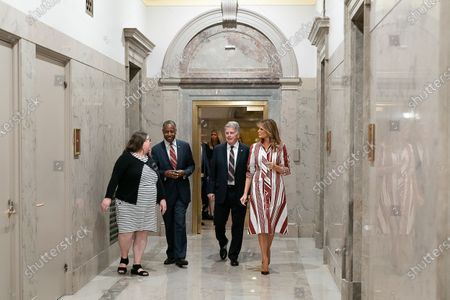 Stock Photo of First Lady Melania Trump participates in a visit to the National Archives Museum with Housing and Urban Development Secretary Dr. Ben Carson, the National Archives Museum Archivist David Ferriero, and Special Assistant to the Archivist Maureen MacDonald