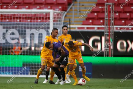 Gonzalo Jara (C) of Mazatlan FC in action against Rafael De Souza (L) and Luis Quinones (R) of Tigres UANL during the GNP Cup for Mexico game between Tigres UANL and Mazatlan FC at the Akron stadium in Guadalajara, Jalisco state, Mexico, 03 July 2020.