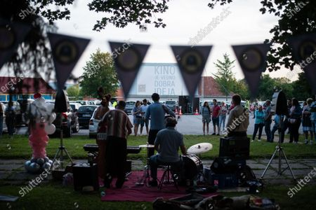 """A music band Joe and The Rhythm Boys perform before the screening of the film """"Grease"""" with John Travolta and Olivia Newton-John at a temporary drive-in cinema parking lot. Due to the spread of the coronavirus (COVID-19) the City Cinema organised outdoor screening."""