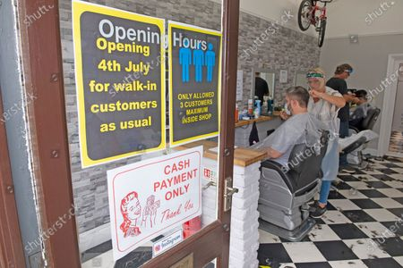 Mr Snips hair studio and Barber shop in Petts Wood high street, Petts Wood, South East London, has reopened today after three months of coronavirus lockdown. Staff and customers have to wear PPE.