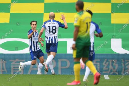 Leandro Trossard (L) of Brighton celebrates with teammate Aaron Mooy after scoring the opening goal during the English Premier League match between Norwich City and Brighton & Hove Albion in Norwich, Britain, 04 Juy 2020.