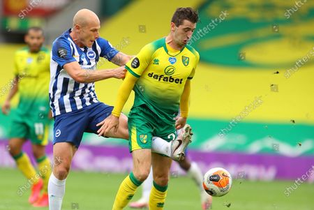 Kenny McLean (R) of Norwich in action against Aaron Mooy of Brighton during the English Premier League match between Norwich City and Brighton & Hove Albion in Norwich, Britain, 04 Juy 2020.