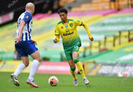 Jamal Lewis (R) of Norwich in action against Aaron Mooy of Brighton during the English Premier League match between Norwich City and Brighton & Hove Albion in Norwich, Britain, 04 Juy 2020.
