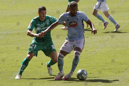 Vigo's Rafinha Alcantara (R) in action against Betis' Guido Rodriguez (L) during the Spanish La Liga soccer match between Celta Vigo and Real Betis at Balaidos stadium in Vigo, northern Spain, 04 July 2020.