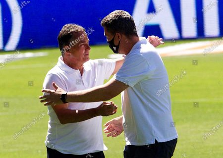 Vigo's head coach Oscar Garcia Junyent (R) greets Betis' coach Alexis Trujillo (L) ahead of the Spanish La Liga soccer match between Celta Vigo and Real Betis at Balaidos stadium in Vigo, northern Spain, 04 July 2020.