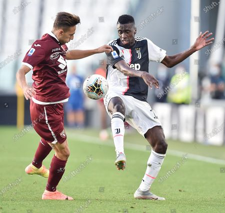 Juventus' Blaise Matuidi (R) in action against Torino's Sasa Lukic (L) during the Italian Serie A soccer match between Juventus FC and Torino FC in Turin, Italy, 04 July 2020.